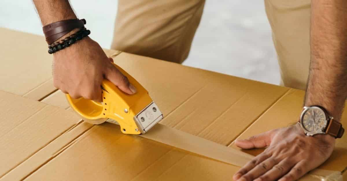 Man Taping Shipping Box